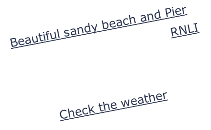 Beautiful sandy beach and Pier Annual Life Guard exhibition RNLI Boating Fishing Check the weather